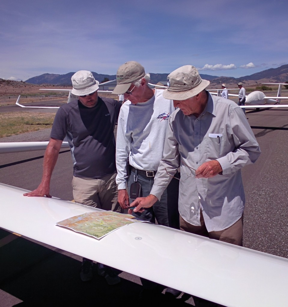 Flight line strategy session. From left: Mike Robison, Dave Nadler, and Dick VanGrunsven